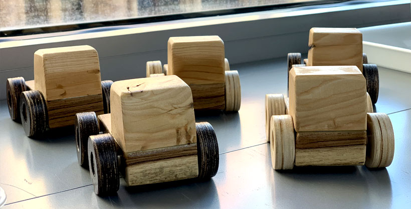 5 wooden toy cars